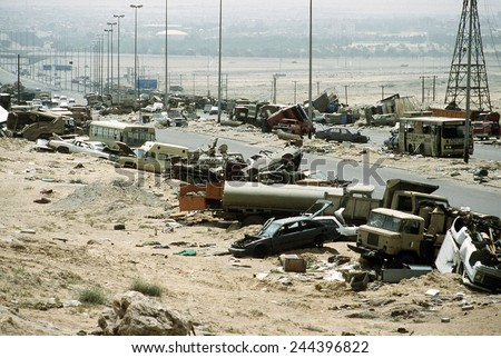 Demolished vehicles line Highway 80 the 'Highway of Death' were destroyed as Iraqi forces retreated from Kuwait during Operation Desert Storm. April 8 1991 - stock photo
