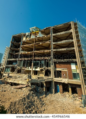 Demolition building background with Pieces of Metal and Stone are Crumbling from Demolished Building Floors - stock photo