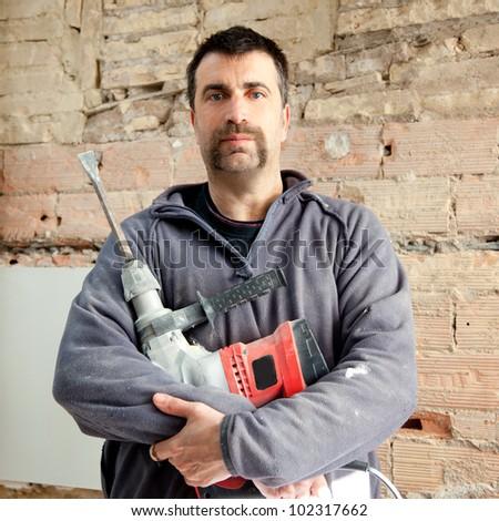 demolition hammer man mason manual worker portrait with mustache - stock photo