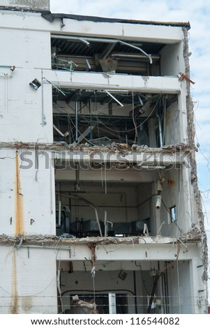 Demolition of a building house in a construction site - stock photo