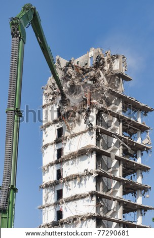 Demolition of a highrise building - stock photo