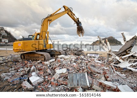 demolition of a hot dog stand at the beach in San Sebastian - Donostia, Spain - stock photo