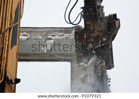 Demolition of flats using hydraulic shears - stock photo
