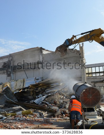 Demolition of industrial building - stock photo