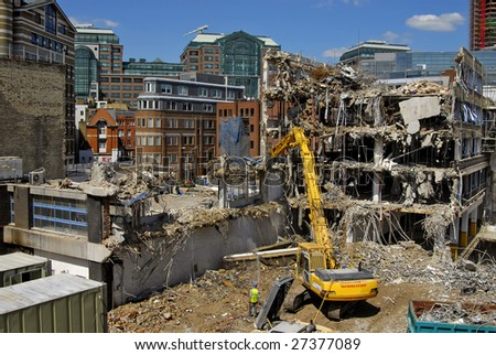 Demolition site showing excavator in action, London UK - stock photo