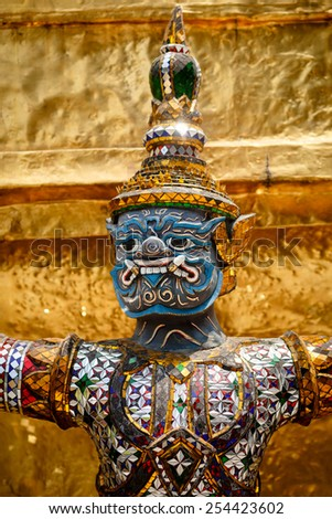 Demon guardian statue at the temple Wat Phra Kaew in the Grand palace, Bangkok, Thailand. - stock photo