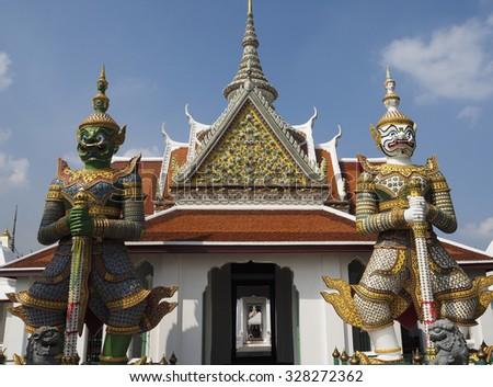 Demon Guardian Statues at Wat arun,bangkok thailand.The atmosphere before the rain - stock photo