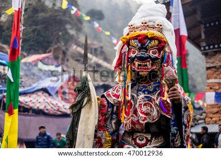 Demon mask during traditional Buddhist ceremony in Nepal