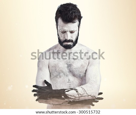Demon with his eyes closed over ocher background - stock photo