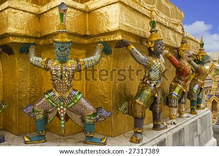 Demons mythical creatures guarding the Golden Stupa also known as Phra Sri Ratana Chedi - Grand Palace Bangkok Thailand - stock photo