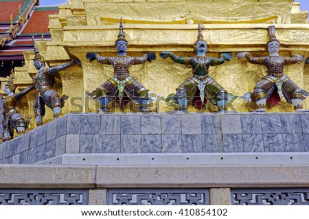Demons supporting the Golden Chedi at the Grand Palace in Bangkok, Thailand - stock photo