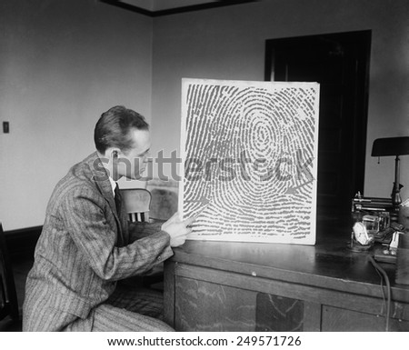 Demonstration of a fingerprint reconstructed from a verbal description received by telephone or telegraph, Jan. 13, 1930. - stock photo