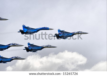 Demonstration of team work by russian pilots on SU-27 - stock photo