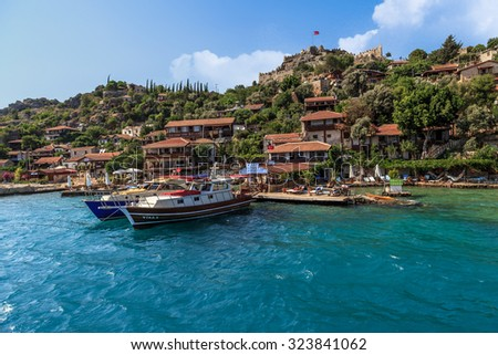 DEMRE, ANTALYA - JULY 18, 2015 : Seascape of Kekova Ancient Lycian City in Antalya, with sailing boats and yachts around, on bright blue sky background.