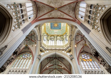 DEN BOSCH - FEBRUARY 25: Ceiling in symmetrical composition in the cathedral of Saint John, with eye of God high above in Den Bosch, 's-Hertogenbosch, Netherlands, February 25, 2014.
