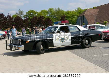DEN BOSCH, THE NETHERLANDS - MAY 10, 2015: 1978 Dodge Monaco California Highway Patrol car on the parking lot at the Rock Around The Jukebox event. - stock photo