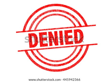 DENIED Rubber Stamp over a white background. - stock photo