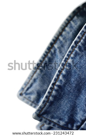 Denim indigo blue jeans jacket collar, isolated macro closeup, large detailed vertical classic bluejeans studio shot  - stock photo