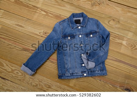 Denim jacket on wooden background