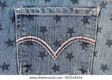 Denim jeans pocket, with star stamp print background, close up, fashion background - stock photo