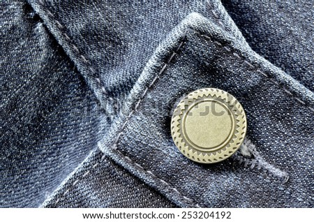 Denim pants with detail of brass button and seams - stock photo