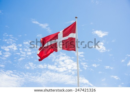 Denmark flag with sky background - stock photo