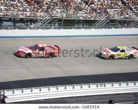 Denny hamlin and gregg biffle racing on the nascar track at dover