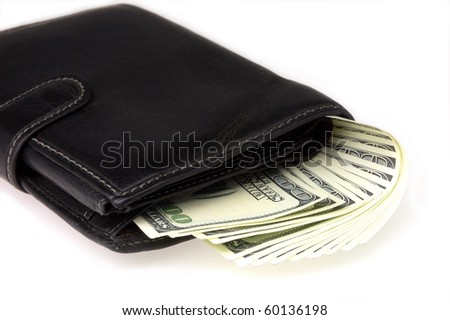 Denominations of one hundred dollars in a wallet