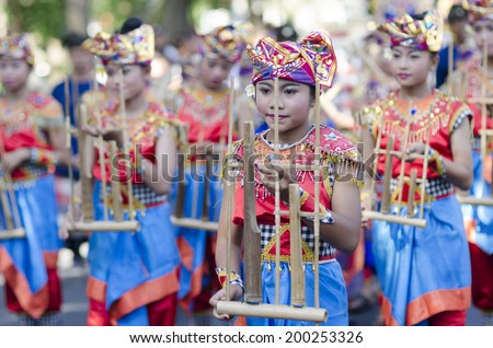 DENPASAR, BALI, INDONESIA - JUNE 18: Unidentified dancer of Balinese in colorful dresses variety on the parade at Bali Art Festival on June 18, 2014 in Denpasar, Indonesia - stock photo