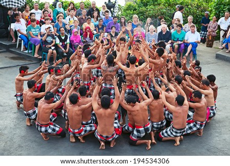 DENPASAR - JULY 27: Traditional Balinese Kecak dance shown in Denpasar, Bali, Indonesia on July 27, 2010. Kecak (also known as Ramayana Monkey Chant) is very popular cultural show on Bali - stock photo