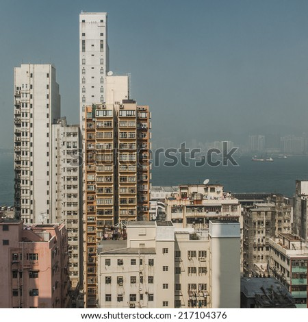 dense city skyline in hong kong  - stock photo