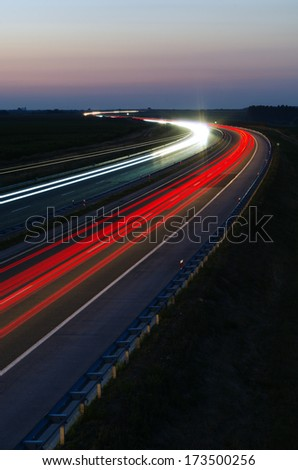 Dense traffic on a highway at night - stock photo