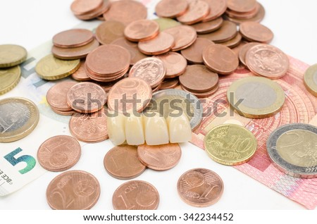 dental bridge with cash - stock photo