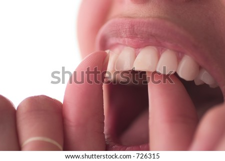 Dental care concept: Floss your teeth. - stock photo