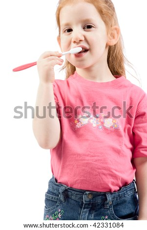dental care - Young girl cleaning her teeth with pink toothbrush