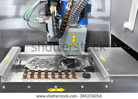Dental CNC engraver in action. Dental milling machine carving out previously  scanned and computer manipulated model of human teeth. - stock photo