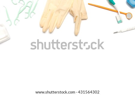 Dental Equipment,Toothbrush and dental tools on a white background, Used rubber gloves, cotton, floss , toothbrush,Thermometer and glass for teeth. - stock photo
