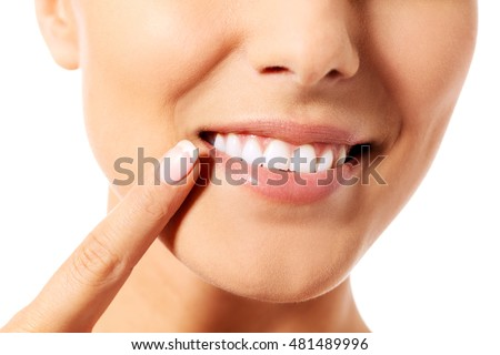 Dental health concept - beautiful woman pointing to her teeth