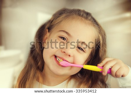 Dental hygiene. Little girl brushing her teeth