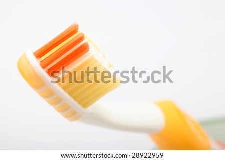 dental hygiene yellow  toothbrush detail on white background