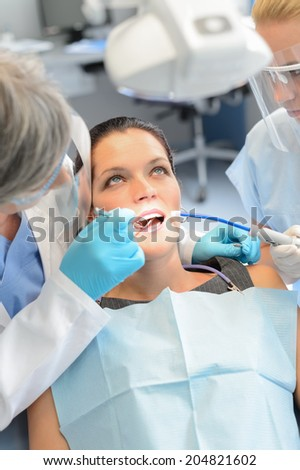 Dental team checkup woman patient teeth open mouth stomatology clinic - stock photo
