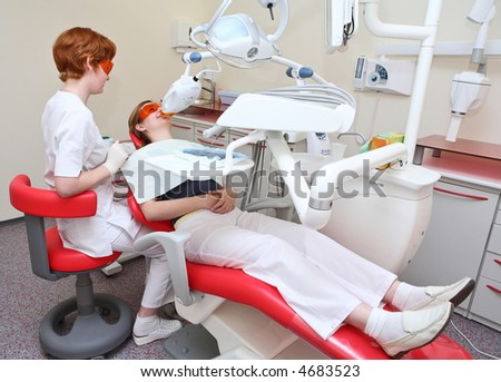 Dentist at work in dental room