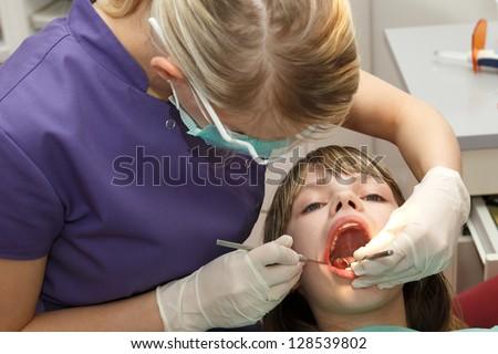 dentist check young girl teeth - stock photo