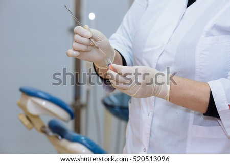 Dentist doctor hand holding medical tools in dental office. Concept of healthy