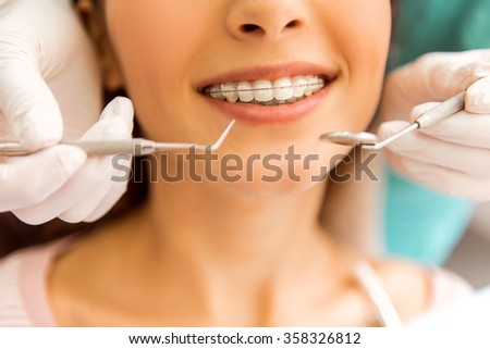 Dentist examines the teeth of his patient. Close-up - stock photo