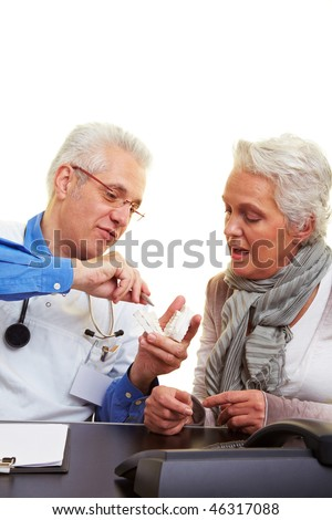 Dentist explaining dental prints to his patient - stock photo