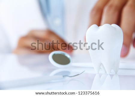 dentist holding molar,dental concept - stock photo