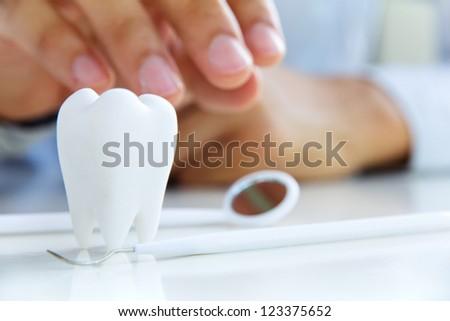 dentist holding molar,dental concept - stock photo