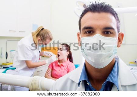 dentist in office - stock photo