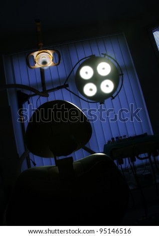 Dentist room and treatment chair - stock photo